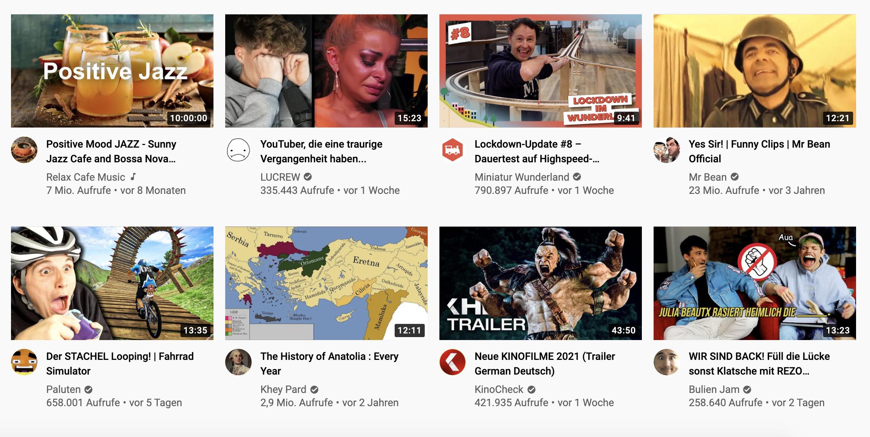 Zu sehen ist ein Screenshot der YouTube-Startseite. Hier findest Du Videovorschläge, die in Form von Thumnails und des Videotitels angezeigt werden.